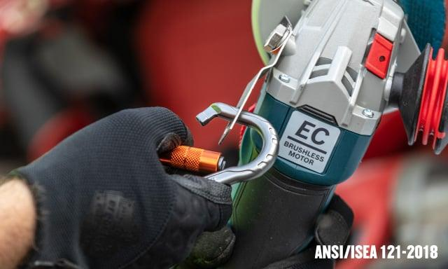Attaching a tool lanyard to a tool