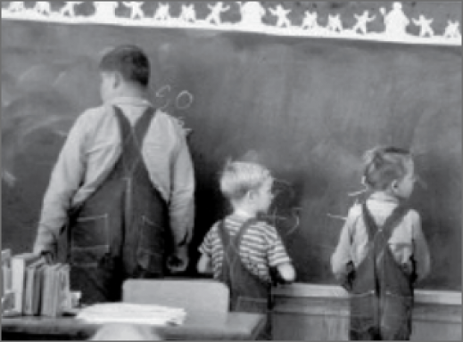 students at a chalk board