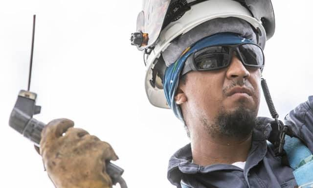 Worker wearing safety glasses