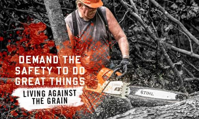 Demand the safety to do great things: living against the grain. Man using chainsaw on tree
